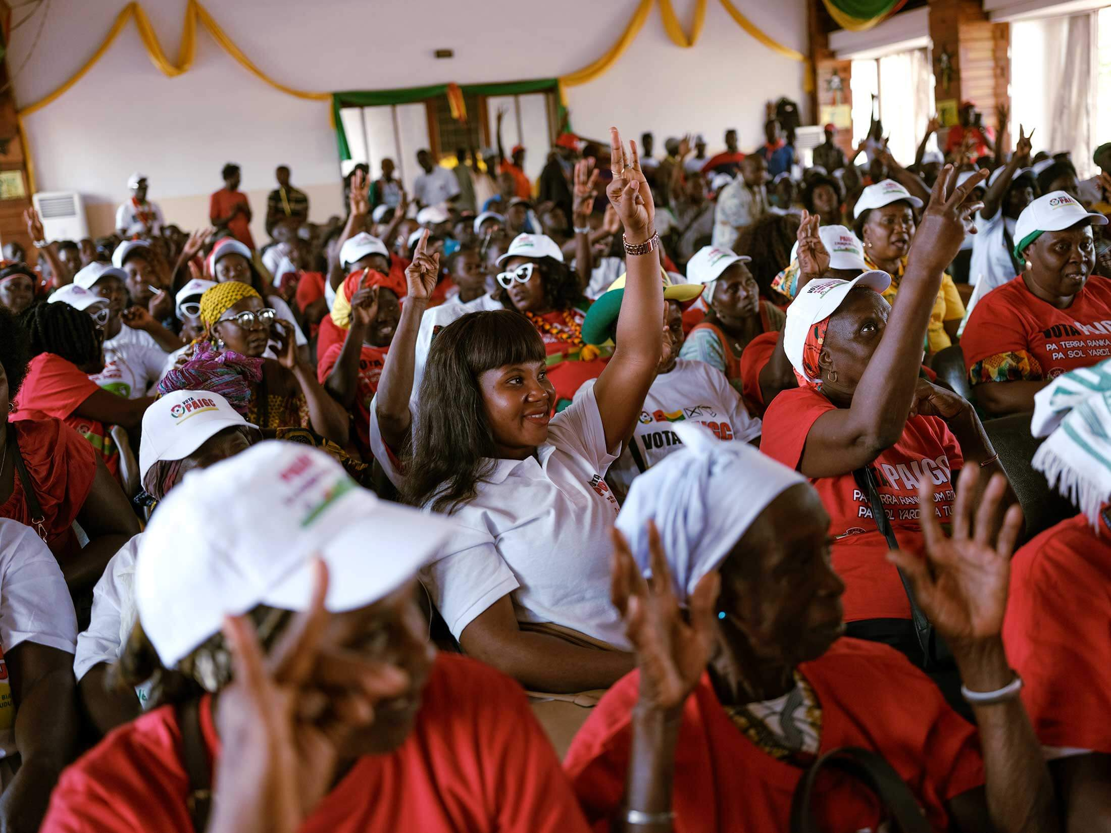 In Guinea-Bissau, women gather for an event on International Women's Day, two days before legislative elections.