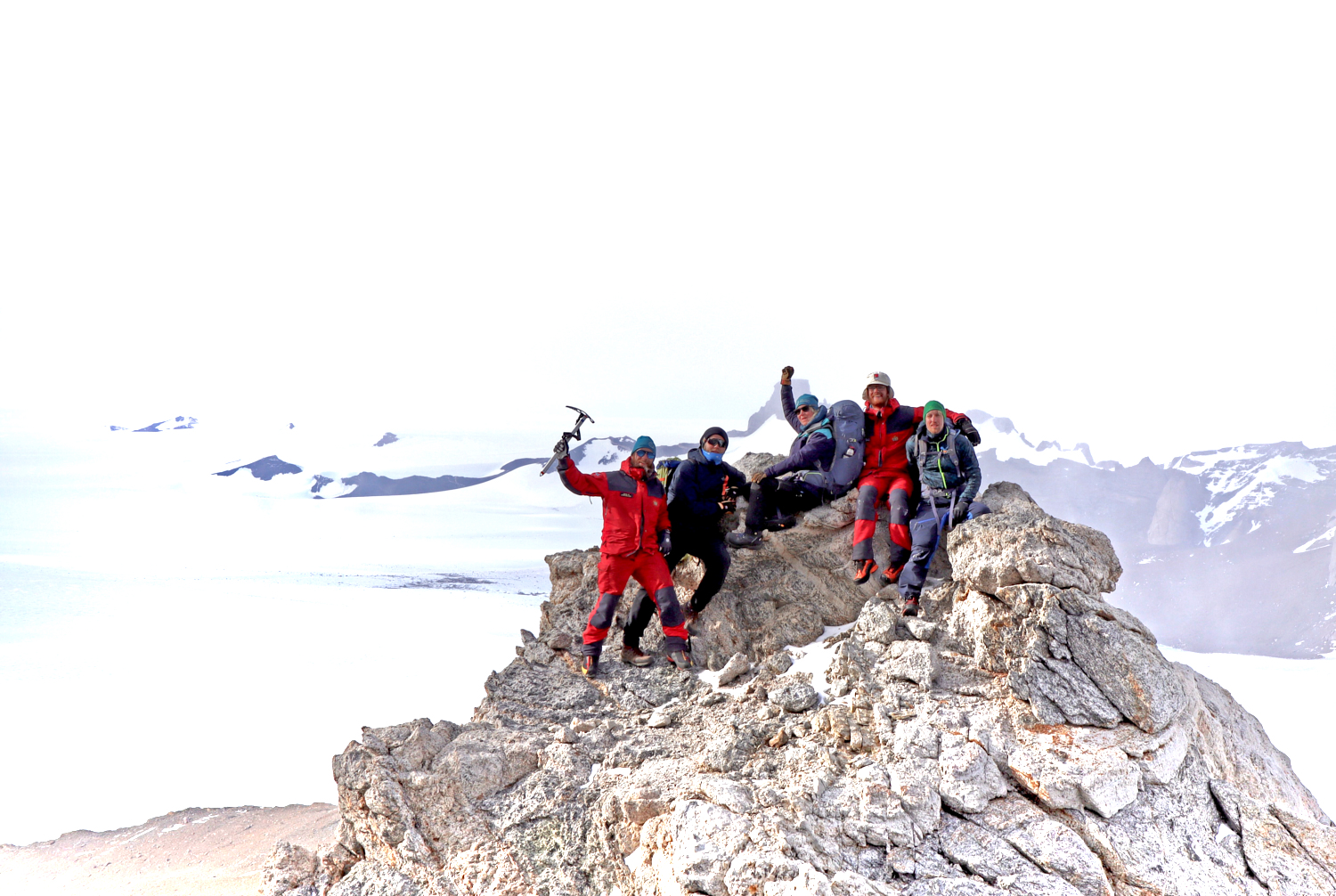 Jansdotter hikes in the nearby mountain together with the overwintering team in summer time when the midnight sun is out 24 hours. From left to right: Alexander Sola, electrician; Aleksander Tvedt, plumber; Karin Jansdotter, chef; Roald Klingsheim, research technician; Thomas Dretvik, doctor. (Photo: Alexander Sola)